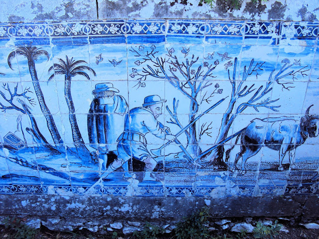 Panels of azulejos depict country life during each month of the year.