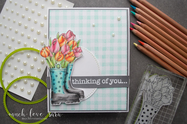 This springtime card, features the gorgeous Fun Stampers Journey  Blooms in Boots Stamp set (available exclusively as a Bloom Benefit through the end of March). Colored with the Journey Color Burst color pencils - find out how to get a step by step video tutorial on how to color this image - as a FREE purchase bonus - in the blog post