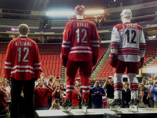 Carolina Hurricanes captain Eric Staal models the team s new jersey - Peter  Koutroumpis 55c6397b5