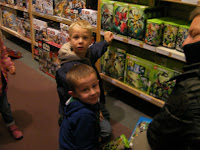 boys choosing lego sets in john lewis