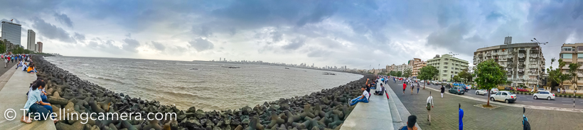 While roaming around Mumbai city, I stopped at Marine Drive for few minutes. Walked around the sea and noticed lot of Mumbaiwalahs enjoying the beautiful day. This place certainly tells a lot about the city.      Marine Drive is essentially a 3 kilometers long road aligned with seashore, which connects Nariman Point tp Babulnath and Malabar Hill in South Mumbai. The promenade lies parallel to this road. Marine Drive is also known as the Queens's Necklace as it looks beautiful in night.     I found this place very interesting, but unfortunately we were in a hurry to catch the flight. And we were very scared of Mumbai traffic and didn't want to miss the flight. This place made me feel very happy. I loved the way people were out of their houses and spending some peaceful moments around this place. I couldn't think of any such place in Delhi. My friend gave a reason that there are not much open places in Mumbai where people can go after office. I don't know about that, but overall it was very happy feeling to be around Marine Drive.     The conversation with my friend on Marine Drive, lead me to think about working in Mumbai for some time and experience this different culture. I know lot of folks who are fan of Mumbai and I also want to be the one.   Hope I get to spend more time in the city and know how it's different from other parts in our country.