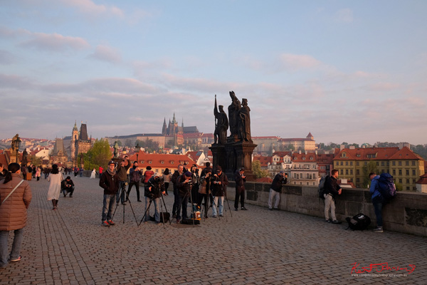 Photographers with tripods bloc the middle of the Charles Bridge in Spring Prague by Travel and Lifestyle Photographer Kent Johnson.
