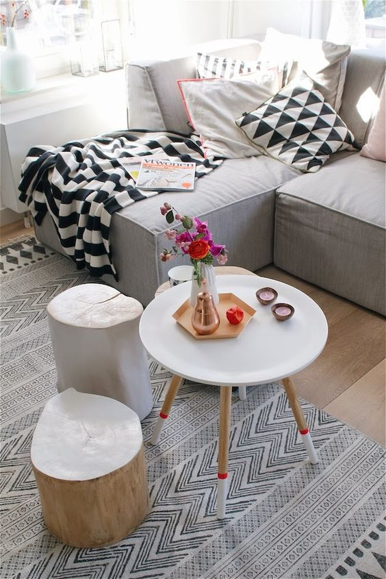 Good  or three small round tables of different size height and style I adore the bination of a central round coffee table with the mix of a wooden stool