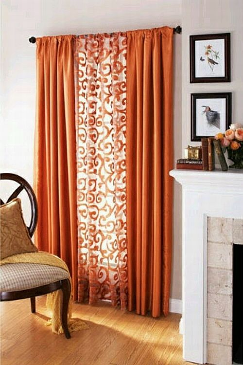 Classy Living Room Details With Orange Curtains And Pictures