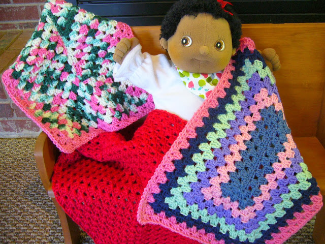 Granny square crocheted lovey for an Operation Christmas Child shoebox.
