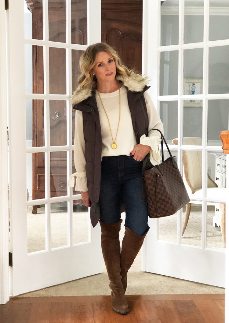 long vest, tie sleeve sweater with skinny jeans and over the knee boots