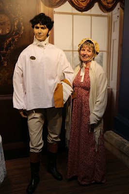 Rachel in Regency costume posing with Mr Darcy  at the Jane Austen Centre in Bath