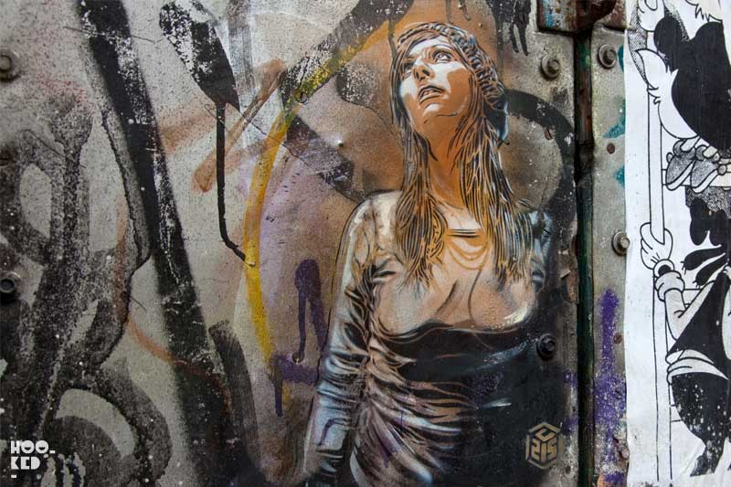 C215 - Brick Lane Street Art spray-painted on a door