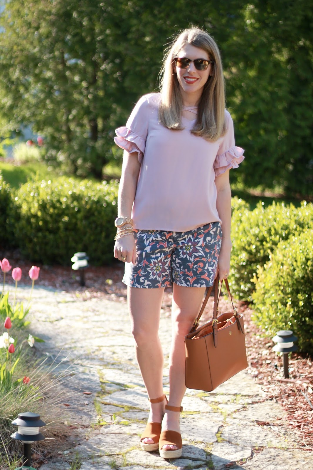 blush blouse, LOFT floral shorts, Steve Madden wedge sandals, Tory Burch tote