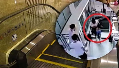 chinese woman swallowed escalator