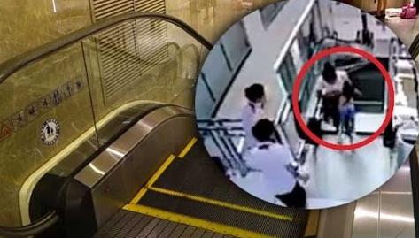 chinese woman swallowed escalator