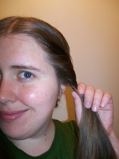 Twisting the side hair.