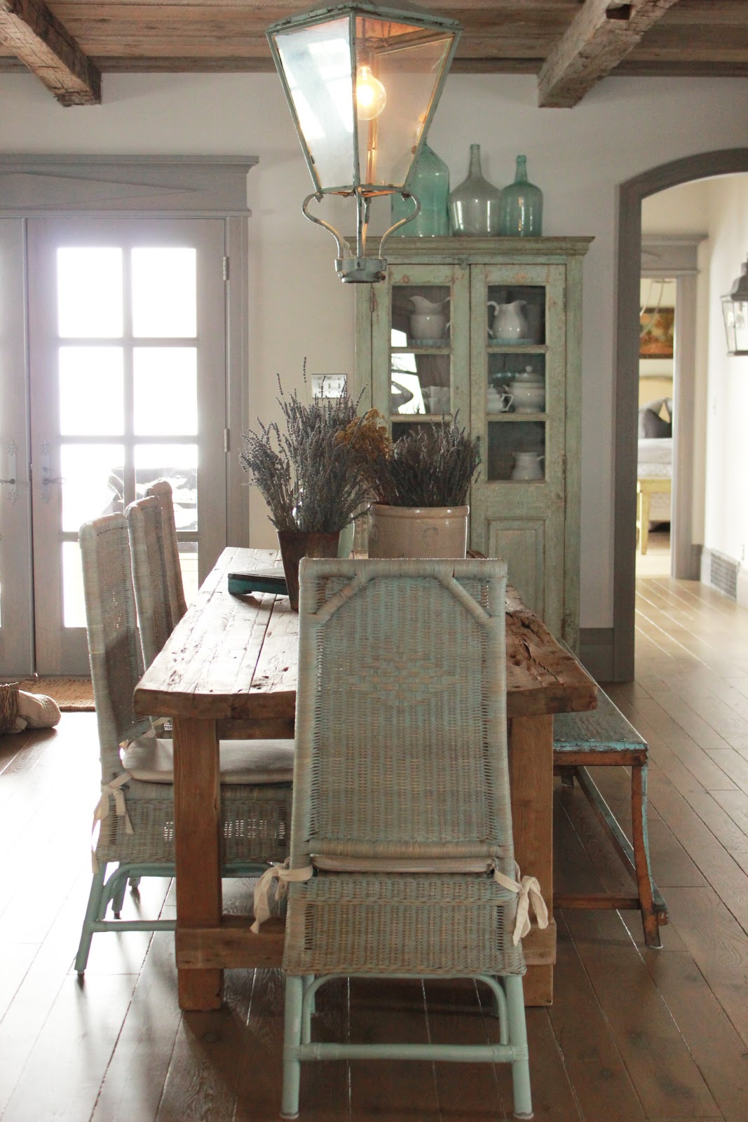 Beautiful rustic elegant Nordic French farmhouse dining room with vintage cupboard and green accents #farmhousediningroom #FrenchCountry #rusticdecor