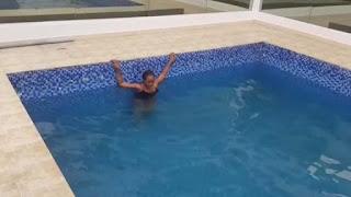 Linda Ikeji Rocks Swimsuit As She Swims In Her Mansion (Photos,