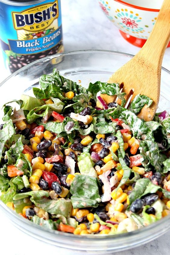 Black Bean Taco Salad Recipe – a lighter version of the classic taco salad. Packed with vegetables and black beans in place of chicken for protein. The dressing is simply irresistible!