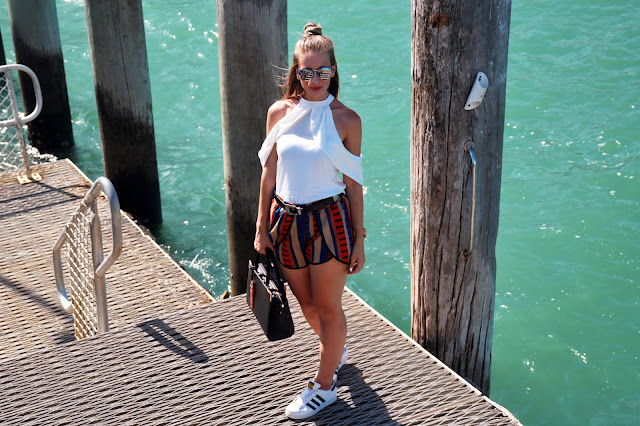 nautical outfit idea striped shorts white blouse adidas superstars