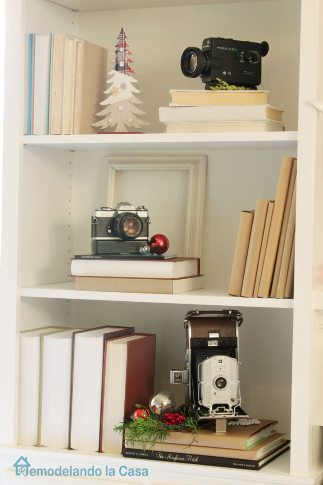 Bookcases decorated with vintage cameras for Christmas