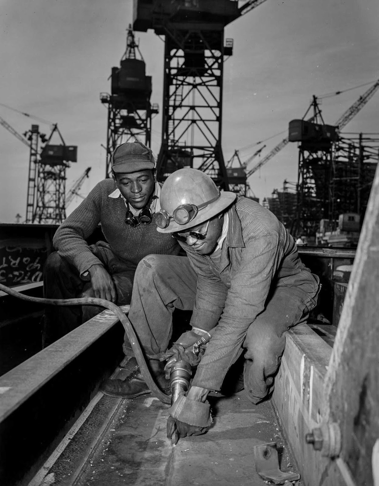 A chipper removes excess metal from a welded seam aboard the Liberty ship Frederick Douglass.