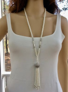 https://www.amazon.in/gp/search/ref=as_li_qf_sp_sr_il_tl?ie=UTF8&tag=fashion066e-21&keywords=pearls necklace single long stand&index=aps&camp=3638&creative=24630&linkCode=xm2&linkId=d8640c61a27db306da62c0d142b1f5ce