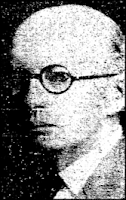 Newspaper clipping of a bald, middle-aged white man wearing round black spectacles, in 3/4 profile and with a grim facial expression