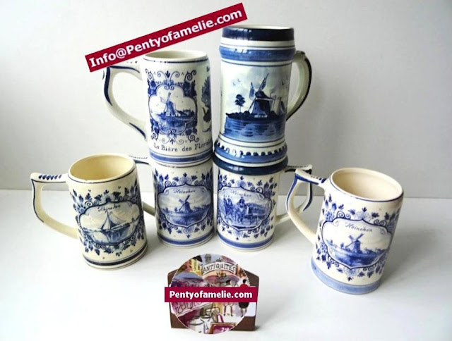 vintage authentic Delft Blue and Delfts Blauw Beer mugs with heineken ads, or with typical Holland scenes