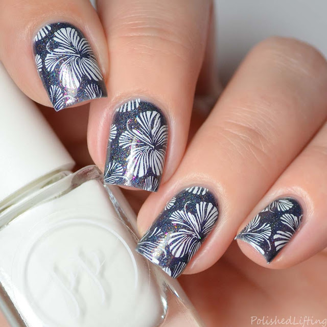 floral stamping over navy nail polish
