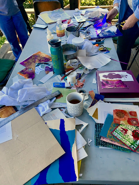 Messy table of art projects