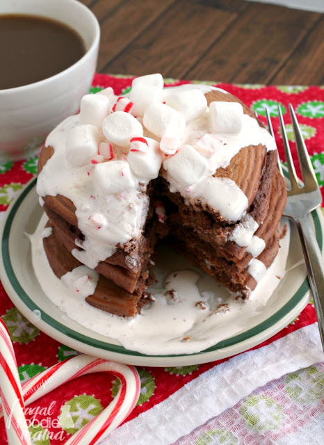 Light & fluffy pancakes are infused with lots of hot cocoa & peppermint flavor, and then topped with a super simple marshmallow cream topping in these Peppermint Hot Cocoa Pancakes.