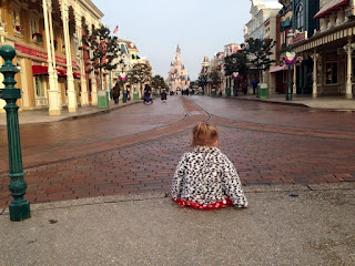 Kairi sitting in front of the castle on main street