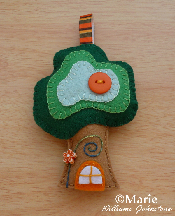 Green and brown felt tree house ornament decorative stitching