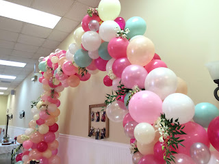 greenery balloon arch in rustic themed