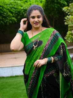 Latest Photos of South Indian Actress Raasi In Green Saree