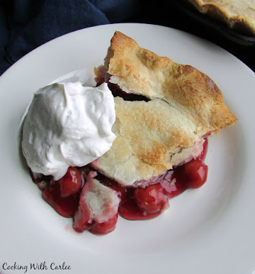 slice of cherry pie with fresh whipped cream