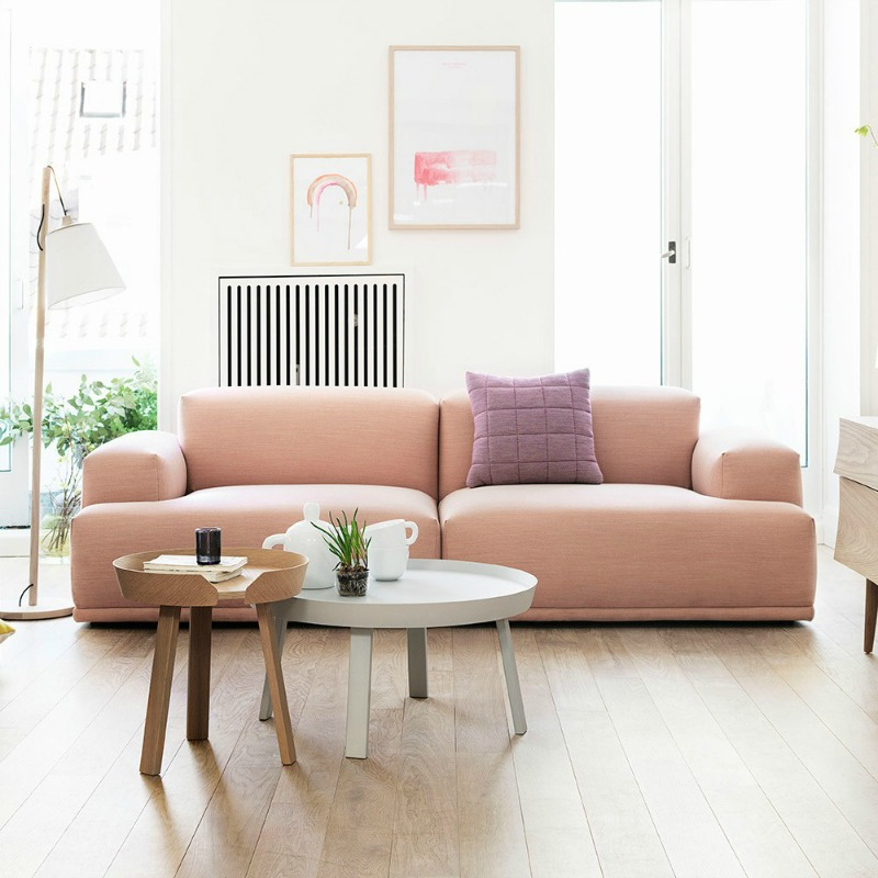 Peach sofa and contemporary tables from Houseology