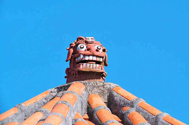 orange roof tiles, monster, dragon, blue sky