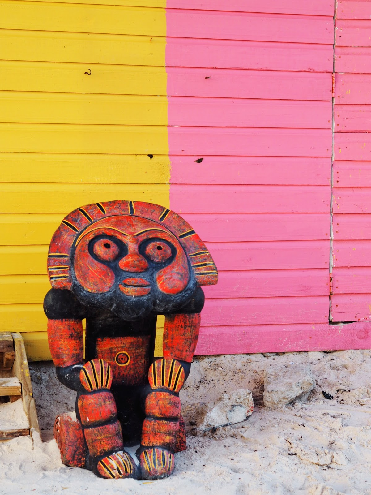 South American God of the Sun with Pink and Yellow Beach Hut background