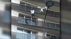 Paris balcony boy