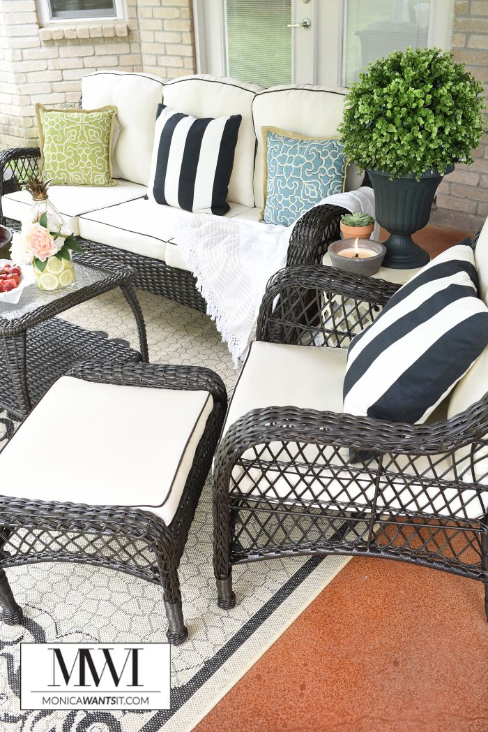 Tips and ideas for an affordable patio makeover that is perfect for lounging and entertaining in your backyard. The patio set that is featured is gorgeous!