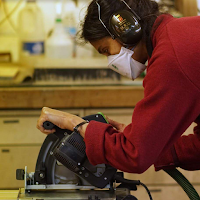 Image of woman using a circular saw