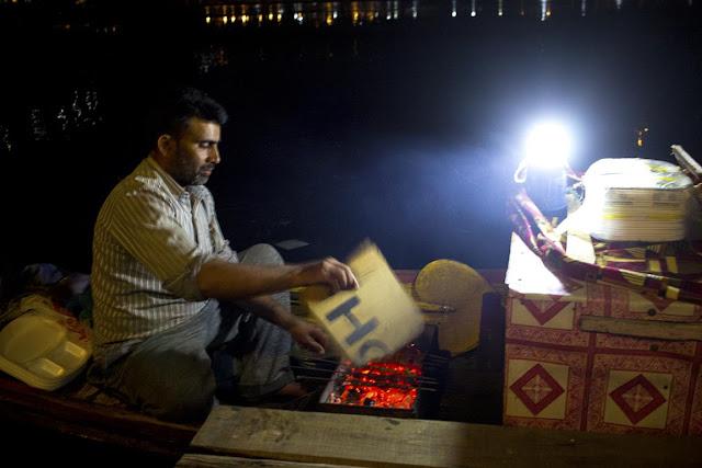 kababwala kebab maker dal lake shikara houseboat srinagar kashmir india