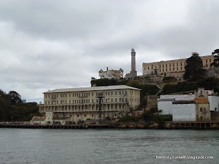 View of Building 64, Warden's house, Lighthouse and Main Cellhouse on Alcatraz