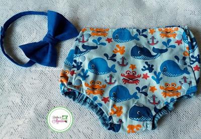 Cobre fralda fundo do mar fechado por botões com gravata borboleta azul royal
