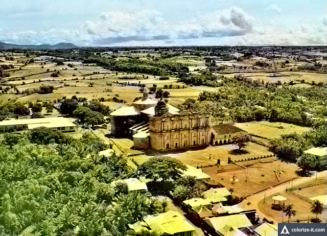 Aerial photograph of Taal Church taken in 1939.  Image source: United States National Archives.  Colorized by Algorithmia.
