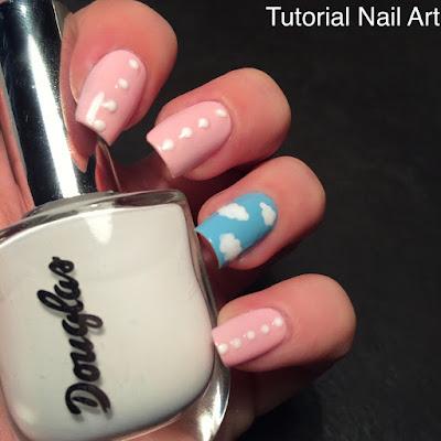 Tutorial nail art rosa con nuvole bianche e pois, realizzato con l'aiuto del dotter per la primavera