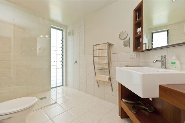 Photo of modern sink and other furniture in the bathroom