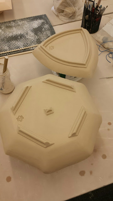 Ceramic serving dishes formed over styrofoam hump moulds, in progress.