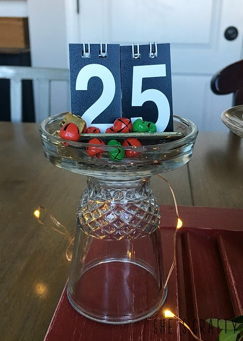 Christmas table centerpiece with DIY candle holders and cloches from thrift store glass ware