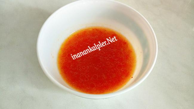 Közlenmiş domates suyu