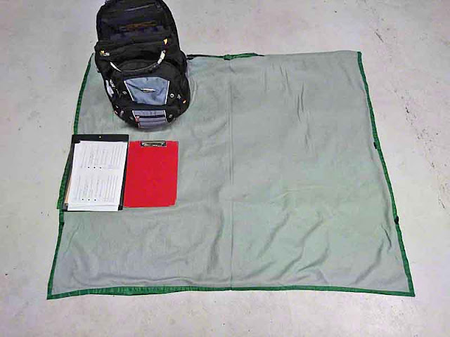 sleeping bag, backpack,clipboards, model releases
