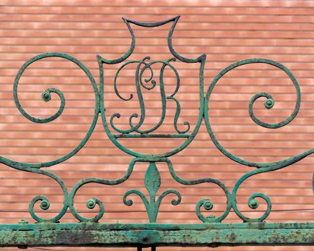 An monogram on an iron gate in Via Gramsci, Livorno